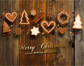 stock photo of christmas spices  - Hanging Gingerbread Christmas Cookies for Xmas Decoration - JPG