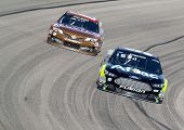 Ft Worth, TX - Nov 03, 2013:  Carl Edwards (99) and Kyle Busch (18) brings their race cars through t