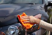 stock photo of cleanse  - Hand with microfiber cloth cleaning car - JPG