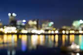 stock photo of portland oregon  - Portland Oregon Downtown Along Willamette River at Blue Hour with Out of Focus City Lights - JPG