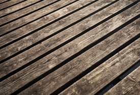stock photo of uncolored  - Uncolored weathered brown wooden lining boards background texture - JPG