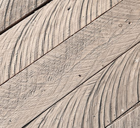 stock photo of uncolored  - Close up texture of rough uncolored wooden lining boards - JPG