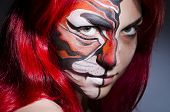 foto of face painting  - Woman with face painting in dark room - JPG