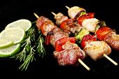 picture of kebab  - Pork kebab on black background - JPG