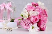 picture of rosa  - Beautiful wedding still life with bouquet on grey wall background - JPG