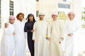 stock photo of turban  - Gulf Arabic Muslim people posing - JPG