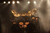 picture of drum-set  - Set of drums on a stage lit with stage lights - JPG