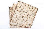 stock photo of piety  - Jewish traditional Pesach textured Matza bread substitute isolated on white background - JPG