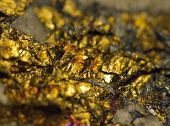 foto of iron pyrite  - Macro a photo extreme close up gold nugget .