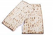 image of piety  - Broken Jewish traditional Pesach textured Matza bread substitute isolated on white background - JPG