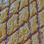 picture of phyllo dough  - baklava closeup traditional middle east desert with nuts and honey syrup  - JPG