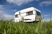 stock photo of caravan  - caravan camping with table and two chairs - JPG