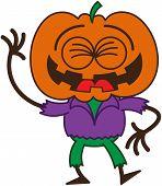 stock photo of scarecrow  - Funny scarecrow with a big orange pumpkin as head - JPG