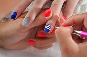 picture of finger-painting  - Finger nail treatment painting lines with brush and lacquer - JPG