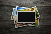 foto of piles  - Pile of colorful photos with blank frame - JPG