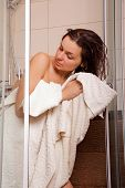 picture of shower-cubicle  - Young woman wiping body by a towel after a shower - JPG