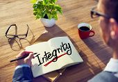 picture of integrity  - Man with a Note and a Single Word Integrity - JPG