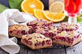 stock photo of racks  - Berry cake bars with caramel almond topping  on a cooling rack - JPG
