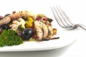 image of kalamata olives  - Spanish Octopus a La Vinagreta with oil and vinegar marinated kalamata olives red and yellow bell peppers and parsley