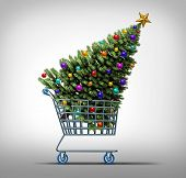 image of friday  - Christmas shopping concept as a store shop cart hauling a decorated festive holiday pine tree as a symbol for black friday sale or purchasing gifts and sales online - JPG