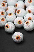 pic of gruesome  - Chocolate candy eyeballs arranged as a background for Halloween - JPG