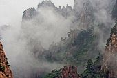 image of shan  - Photo of spectacular rocks and peaks of Huang Shan Mountains China in the mist stylized and filtered to look like an oil painting - JPG