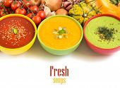 image of vegetable soup  - Three fresh soups in colorful bowls and vegetables - JPG