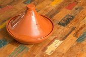 pic of tagine  - Moroccan brown tagine on a colorful table - JPG