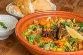 stock photo of tagine  - Moroccan tagine dish with chick peas lamb carrots celery lemon onion cinnamon star anise - JPG