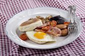 foto of black-cherry  - irish breakfast with muffin black pudding white pudding fried egg grilled cherry tomato and bacon - JPG