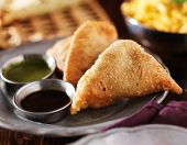 image of samosa  - plate of indian samosa with mint and hot chutney - JPG