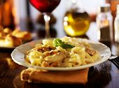 stock photo of glass noodles  - fettuccine alfredo with grilled chicken dinner at night - JPG