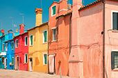 stock photo of row houses  - Colorful houses in a row on the Venetian island Burano  - JPG