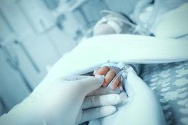 stock photo of icu  - Care for a sick child in the pediatric ICU - JPG