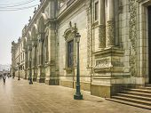 image of neoclassical  - Low angle view of beautiful neoclassical style building in Plaza Mayor in the historic center of Lima city in Peru South America