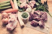 foto of veal meat  - ingredients for the preparation of meat broth with veal and different vegetables whit tone color in instagram effect - JPG