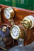 foto of analog clock  - dashboard with analog clocks very old car - JPG