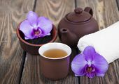 foto of black tea  - Asian tea set with orchid black tea on a wooden background - JPG
