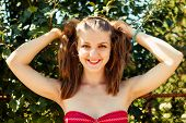 image of ponytail  - Happy young woman with ponytails at nature - JPG