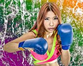 foto of boxers  - Chinese woman boxer with grunge texture in pink top wearing boxing gloves - JPG