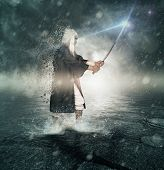 image of saber  - Young samurai with his magic saber for the fight - JPG