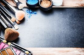 stock photo of foundation  - Various makeup products on dark background with copyspace - JPG