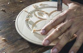 foto of woodcarving  - Woodcarver makes threaded plate - JPG