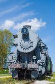foto of locomotive  - Old steam locomotive train under blue sky - JPG