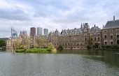 stock photo of prime-minister  - Dutch parliament buildings Binnenhof with skyscrapers in the background in The Hague Netherlands - JPG
