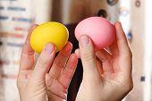 stock photo of battle  - Hands holding easter eggs ready for battle - JPG