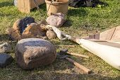 stock photo of mites  - ancient clay forge furs hammer mites and other tools - JPG