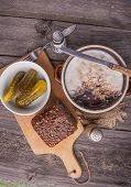 picture of collate  - lard with cracklings in bowl on old wooden table - JPG