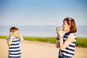 picture of tin can phone  - Kids having a phone call with tin cans on sea background - JPG