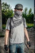 stock photo of war terror  - Man covering face with a scarf - JPG